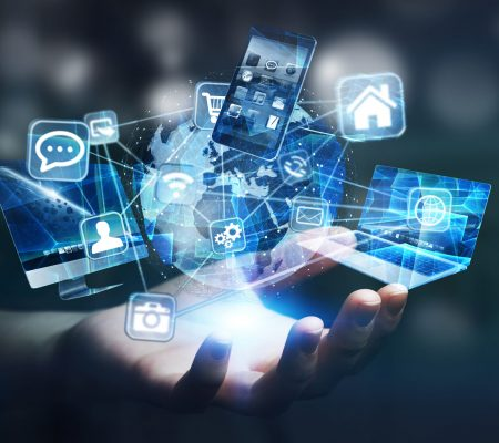 Businesswoman connected tech devices and icons applications to a digital planet earth